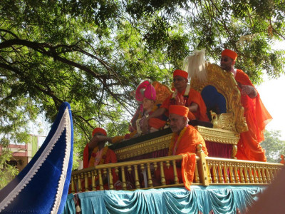 His Divine Holiness Acharya Swamishree blesses all during the grand village procession
