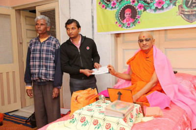 Disciples present a cheque to local charitable organisations