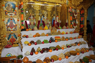 Sants and disciples prepare various sweet and savoury dishes and present to the Lord in the form of annakut
