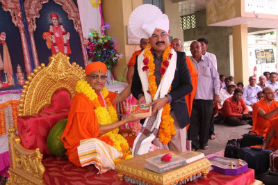 His Divine Holiness Acharya Swamishree blesses the honoured guest