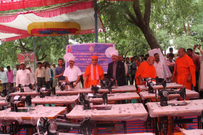 His Divine Holiness Acharya Swamishree blesses the sponsors of the new sewing machines