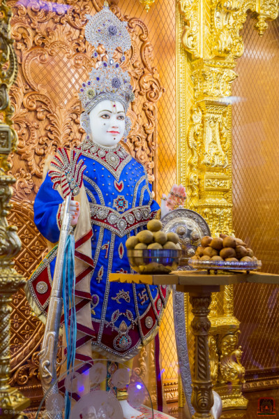 Divine darshan of Lord Shree Swaminarayan dining on sweets and savouries