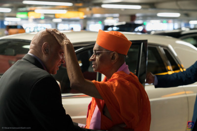 His Divine Holiness Acharya Swamishree blesses the disciple