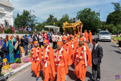 The procession proceeds towards the mandir