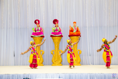 Disciples perform a devotional dance to the devotional song Bapa Malya Anmol