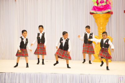 Young disciples perform a devotional dance to the devotional song Bapa ShreejiBapa