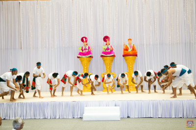 Disciples perform a devotional dance on the devotional song Eva Krupalu Bapashree