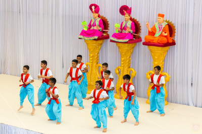 Young disciples perform a devotional dance on the devotional song Balvir Banija
