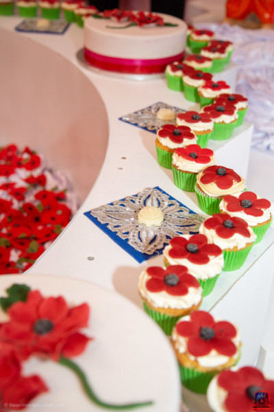 Poppy fairy cakes leading to a large poppy cake