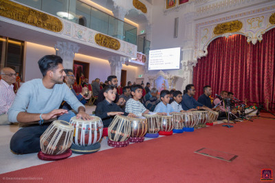 Disciples perform tabla as part of the ekadashi festival celebrations