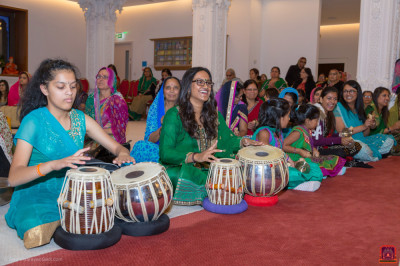 Disciples perform tabla and hand cymbals as part of the ekadashi festival celebrations