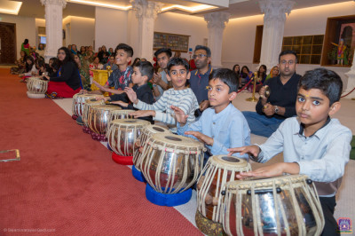 Disciples perform tabla, hand cymbals and various percussion instruments accompanying devotional songs as part of the ekadashi festival celebrations