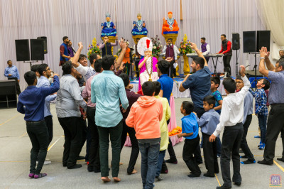 Disciples dance as the raas concludes