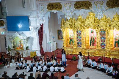 Disciples of Swamibapa Gujarati School present an assembly on divine episodes of Lord Shree Swaminarayan's childhood
