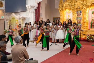 Disciples of Swamibapa Gujarati School sing a devotional song as younger disciples perform a devotional dance