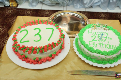 Disciples prepare a cake to celebrate Lord Shree Swaminarayan's 237th manifestation day