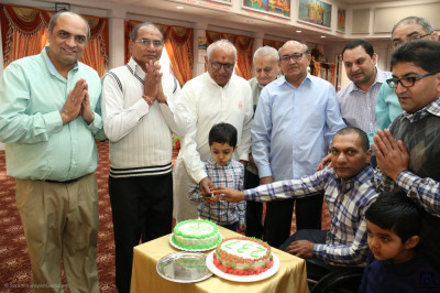 Disciples prepare to cut Lord Shree Swaminarayan's 237th manifestation day cake