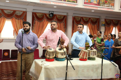 Disciples play the tabla and sing harmonious hymns to celebrate Lord Shree Swaminarayan's 237th manifestation day