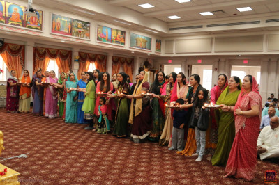 Disciples perform aarti of Lord Shree Swaminarayan in celebration of Lord Shree Swaminarayan's 237th manifestation day