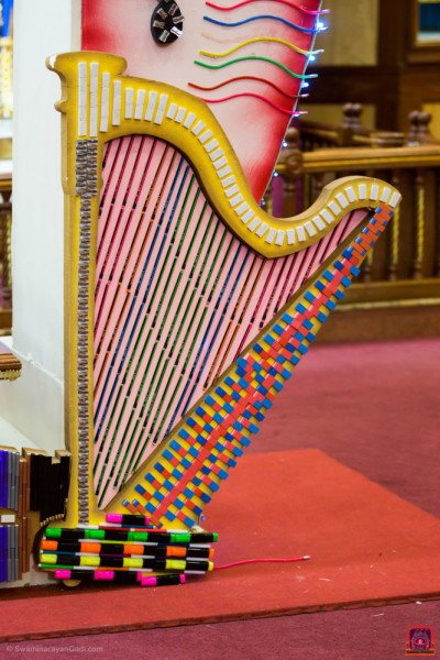 A harp decorated with various stationery