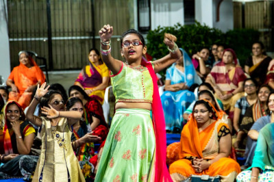 Young devotees perform a welcome dance