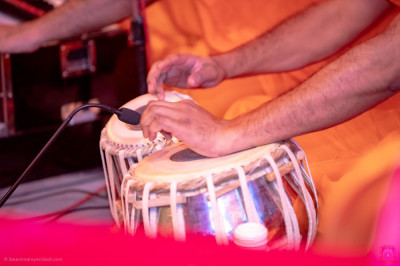 Various musical instruments accompany the devotional songs being sung