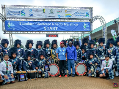 Shree Muktajeevan Swamibapa Pipeband pose for a group photo with the Governor Mike Sonko