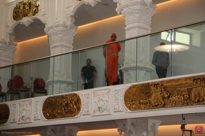 His Divine Holiness Acharya Swamishree Maharaj blesses all from the balcony
