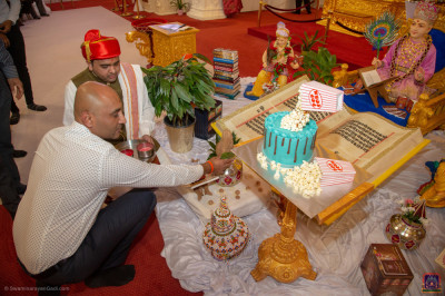 Disciples who have sponsored the celebrations perform poojan