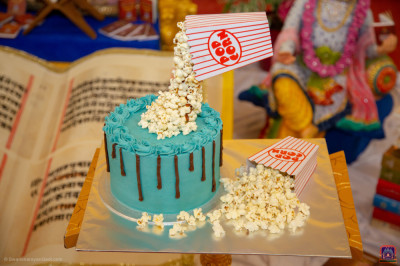 Delicious cake with popcorn is offered to the Lord