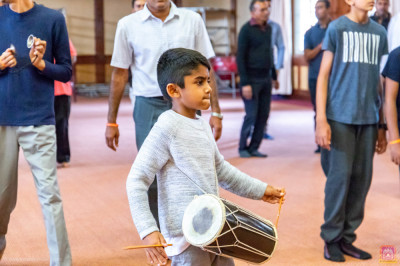Devotees enjoy playing musical instruments