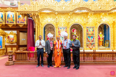Asian Foundation guests and devotees pose for a group photo with H.D.H Acharya Swamishree