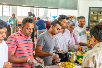 Devotees serving lunch