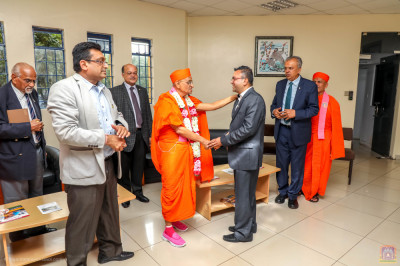 H.D.H Acharya Swamishree blesses one of the members
