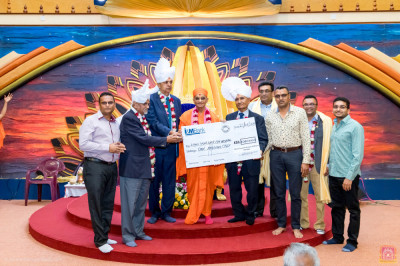 Donation to Lions Sightfirst Eye Hospital in the presence of H.D.H Acharya Swamishree