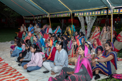 Devotees enjoy the devotional songs being sung