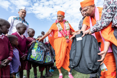 H.D.H Acharya Swamishree gives school bags to the students