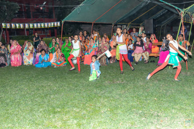 Young devotees perform a devotional dance to please H.D.H Acharya Swamishree