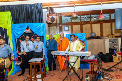 Sants and devotees sing devotional songs along with raas being played