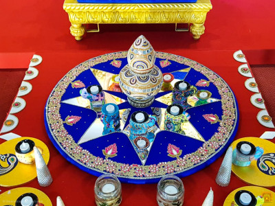 One of the many rangoli creations placed before the Lord