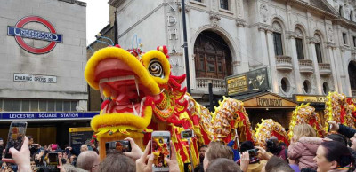 Large dragons take part in the Chinese New Year's Day Parade passing Leicester Square Station