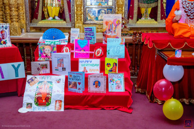 Presentation of birthday cards made by devotees