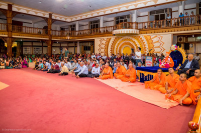 Devotees enjoy the devotional drama performance