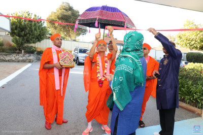 Disciples perform the welcoming ceremony at the entrance of Shree Swaminarayan Mandir Perth