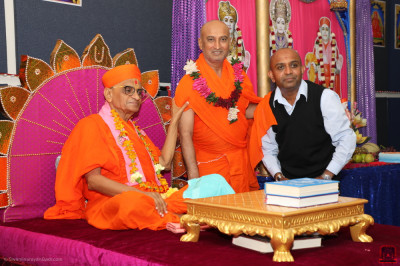 His Divine Holiness Acharya Swamishree blesses the sant and the disciple