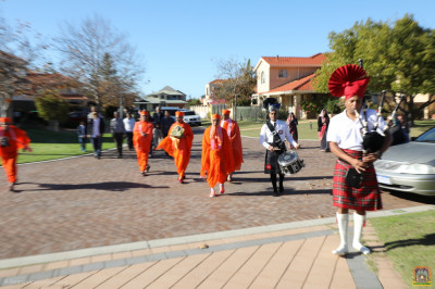 Disciples play bagpipe and snare drums escorting His Divine Holiness Acharya Swamishree and sants