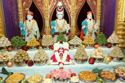 Divine darshan of the Lord dining on the annakut of sweet and savoury items