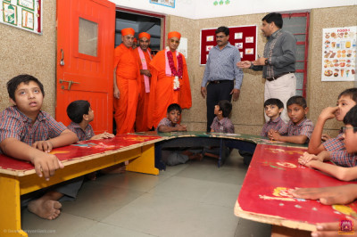 Divine darshan of His Divine Holiness Acharya Swamishree inside the school