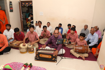 Students and staff perform devotional songs