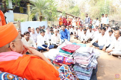 Acharya Swamishree Maharaj gives darshan during the donation of clothes to the needy in Dhaabala